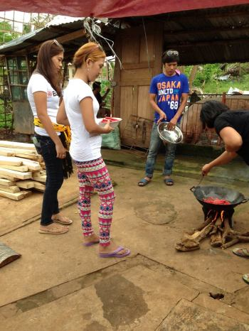 Cooking with logs. It's MORE FUN in the Philippines!