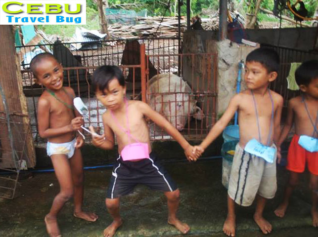 They wouldn't care lying near a pig pen just to win the longest line... And these kids are way too funny... LOL!
