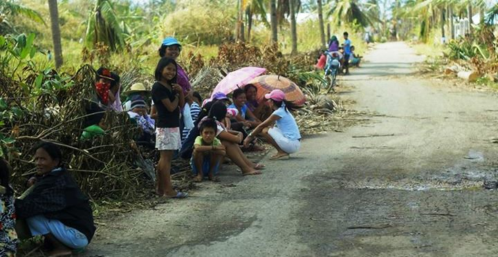 Residents patiently waiting for relief goods  amidst the strong heat of the sun.
